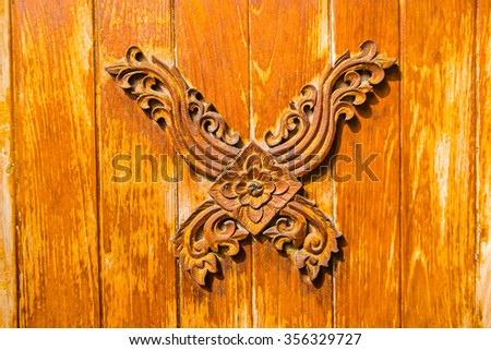 Traditional Thai style on wood - stock photo