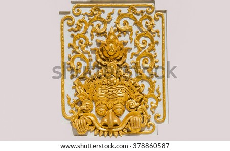 Traditional Thai style pattern decorative stucco gold paint in Buddhist temple Chiang Rai,Thailand ( A giant) - stock photo