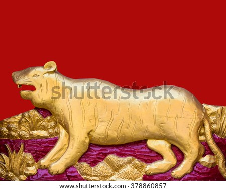 Traditional Thai style pattern decorative stucco gold paint in Buddhist temple Chiang Rai,Thailand (The Year of the Tiger) - stock photo