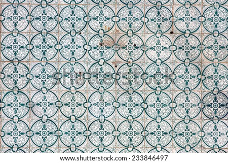 Traditional tiles (azulejos) on facade of old house in Portugal - stock photo