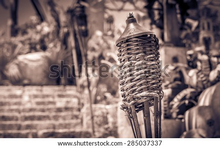 Traditional torch on mexican graveyard on Yucatan - stock photo
