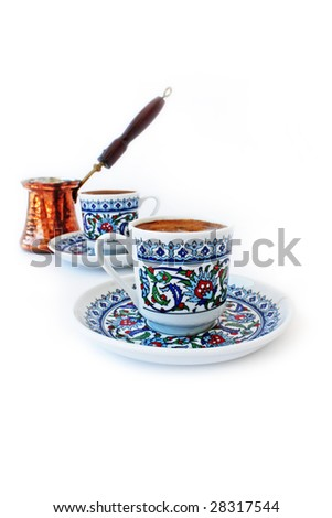 Traditional Turkish Coffee. Mocha with a Cezve. Isolated on white. - stock photo
