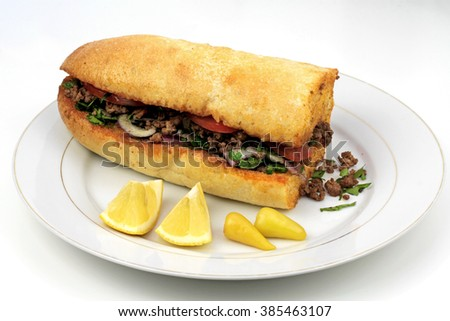 Traditional Turkish cuisine, Tantuni with loaf bread. - stock photo