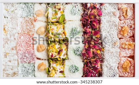 Traditional turkish delight rahat lokum in a box, top view  - stock photo