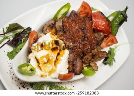 Traditional Turkish food - Iskender kebap - stock photo