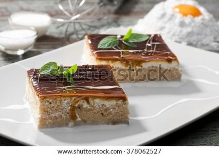 Traditional Turkish three milk cake with caramel on plate.  - stock photo