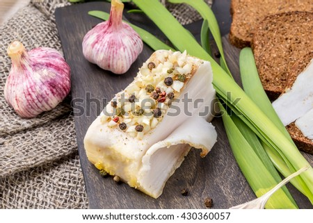 Traditional Ukrainian bacon with bread and garlic - stock photo