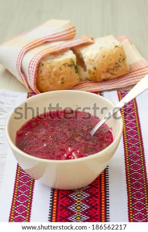 Traditional Ukrainian beetroot soup - red borsch and dumplings - stock photo