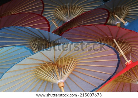 traditional umbrellas, handmade in Chiang Mai, Thailand. - stock photo