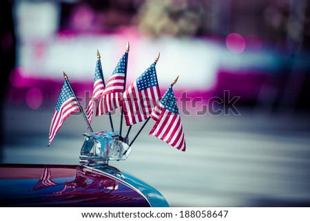 Traditional USA parade old car with flags - stock photo