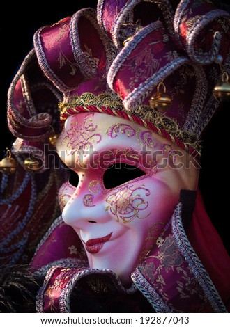 traditional Venetian mask on a black background - stock photo