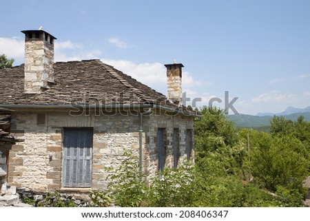 Traditional village of Dilofo at Zagorohoria, Epiros, Pindos mountains in Greece - stock photo