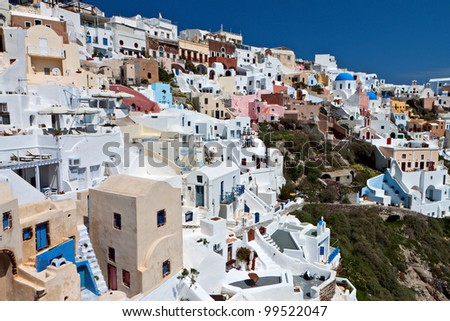 Traditional village of Oia at Santorini island in aegean sea at Greece - stock photo