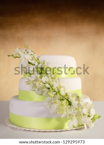 Traditional wedding cake on a color background - stock photo