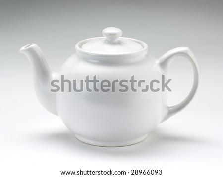 Traditional white china teapot on a white teapot - stock photo