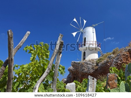 Traditional windmill at Lasithi plateau in Crete island, Greece - stock photo