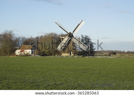 Traditional windmill in Holland - stock photo