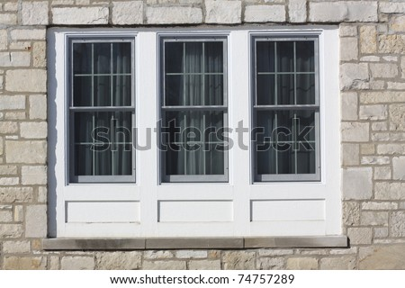 Traditional window with wooden shutters. - stock photo