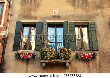 Traditional windows with green shutters of typical old Venice building ,Italy. - stock photo