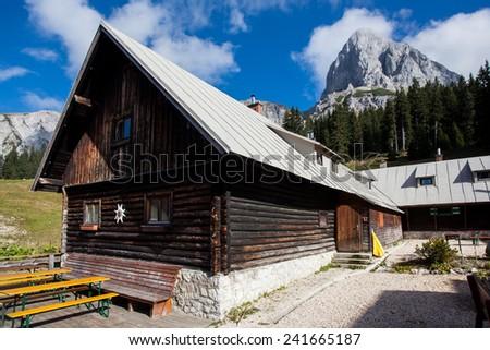 Traditional wooden alpine hut - stock photo