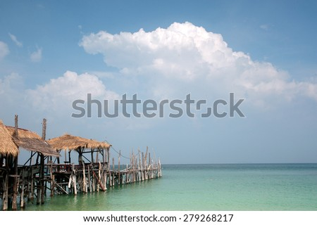 Traditional wooden and bamboo Thai style bridge for relax on the beach. - stock photo