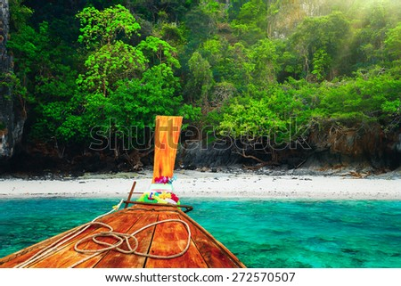 Traditional wooden boat in a tropical bay on Koh Phi Phi Island, Thailand, Asia - stock photo