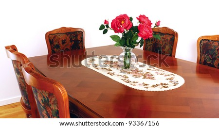 Traditional wooden dining table in a home - stock photo