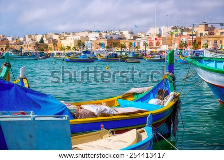 Traditional wooden fishermanâ??s boats in Marsaxlokk town. Malta. - stock photo