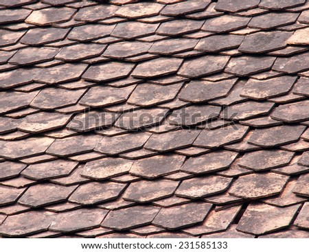 Traditional wooden roof tile of old house, backgrund - stock photo