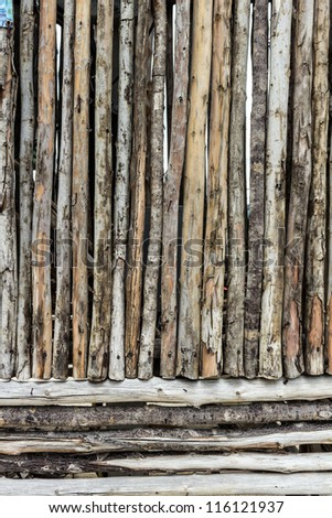 Traditional wooden rural wall from old logs - stock photo