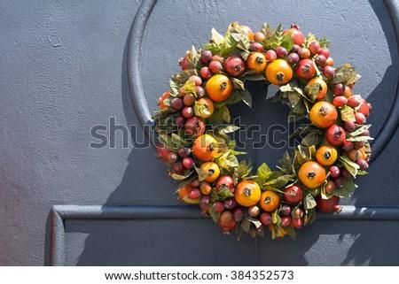 Traditional wreath on doorway - stock photo