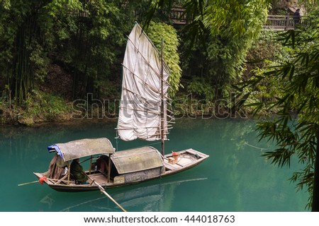 Traditional yacht boat along scenic river in Three Gorges. - stock photo