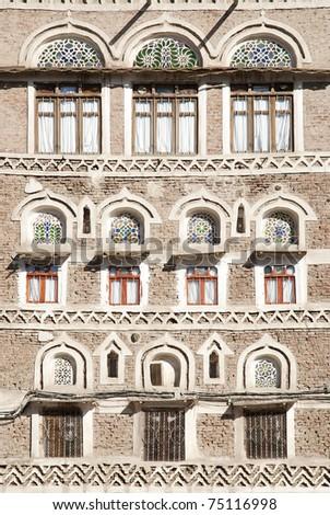 traditional yemeni windows and architecture in sanaa yemen - stock photo