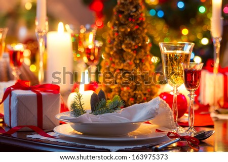 Traditionally decorated christmas table - stock photo
