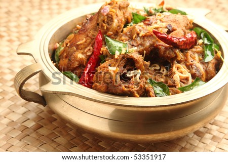 Traditionally served Indian chicken curry - stock photo