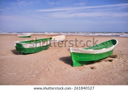 Traditonal fishing boats on a Mediterranean beach, slightly softened to give a pictorial feeling - stock photo