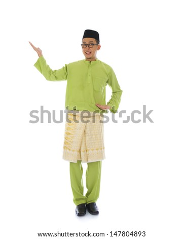 Traditonal Malay man with welcome gesture during ramadan isolated white background  - stock photo