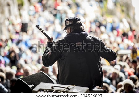 Traena, Norway - July 11 2015: concert of Norwegian singer Anneli Drecker at cathedral cave Kirkehelleren on Sanna Island, at Traenafestival, music festival taking place on the small island of Traena. - stock photo