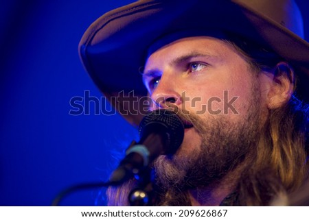Traena, Norway - July 10 2014: during the concert of the indie-folk band from Berlin Mighty Oaks at the Traenafestival, music festival taking place on the small island of Traena - stock photo