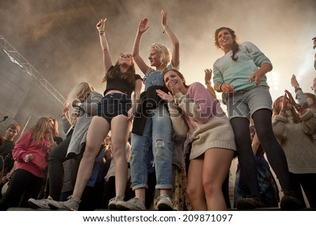 Traena, Norway - July 11 2014: during the concert of the Norwegian band Ida Maria  at the Traenafestival, music festival taking place on the small island of Traena - stock photo
