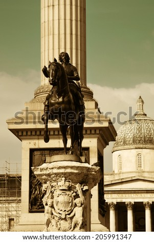 Trafalgar Square with Nelsons Column and statue in London - stock photo