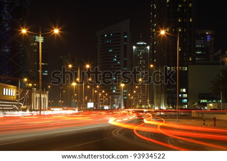 Traffic at night in Doha downtown, Qatar - stock photo