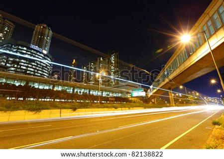 traffic car light in city at night - stock photo