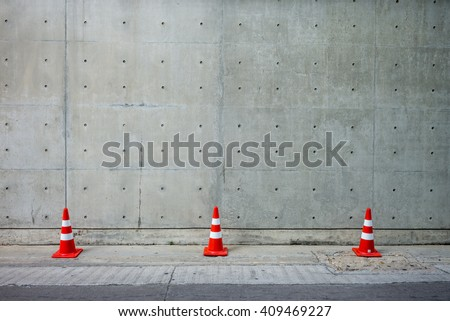 Traffic cone. Concrete wall and Cement floor for Copy Space - stock photo