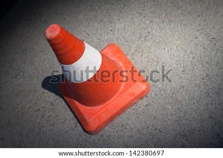 Traffic cone on asphalt surface. - stock photo