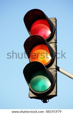 Traffic control signals against the blue sky - stock photo