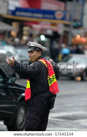 Traffic Cop Directing Traffic - stock photo