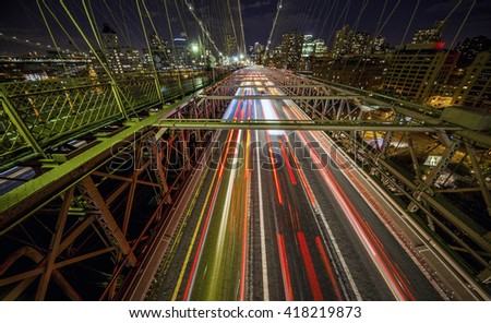 Traffic crossing the Brooklyn Bridge in New York - stock photo