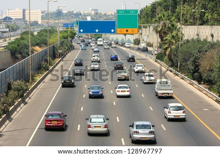 Traffic flow on freeway during rush hour in Tel Aviv, Israel. - stock photo