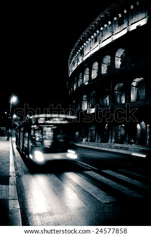 Traffic in front of the Colosseum - stock photo